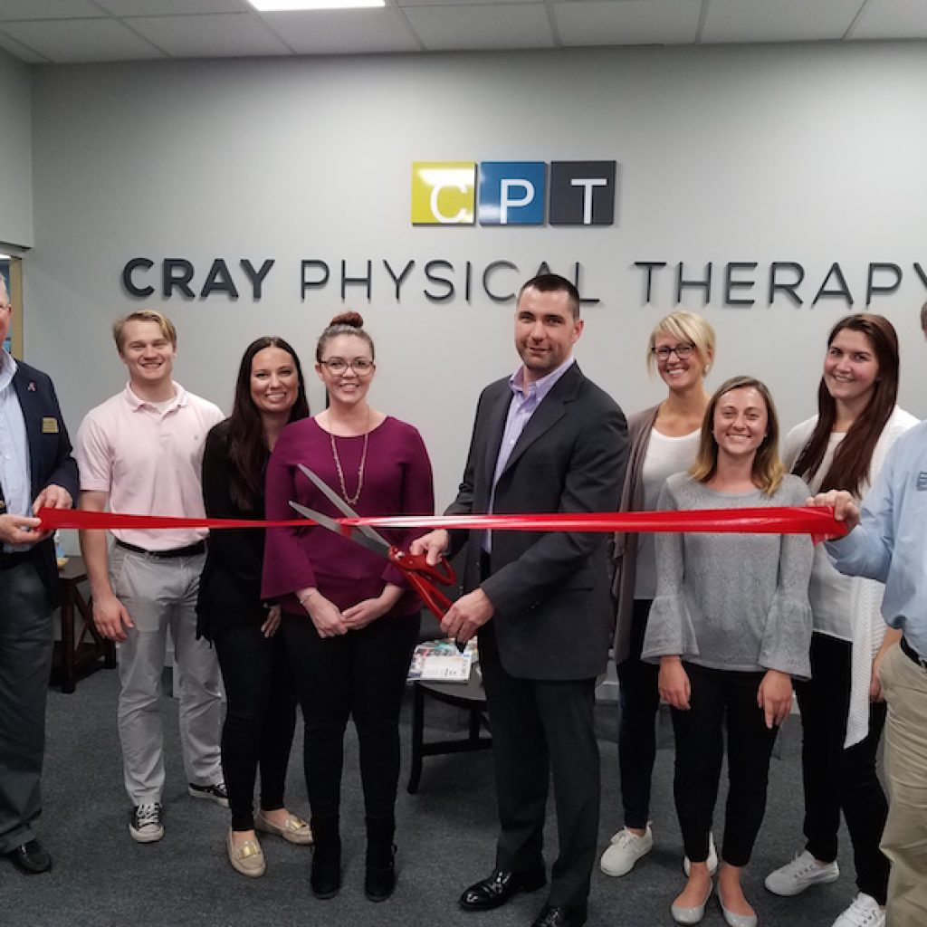 Cray Physical Therapy Staff Cutting Grand Opening Ribbon