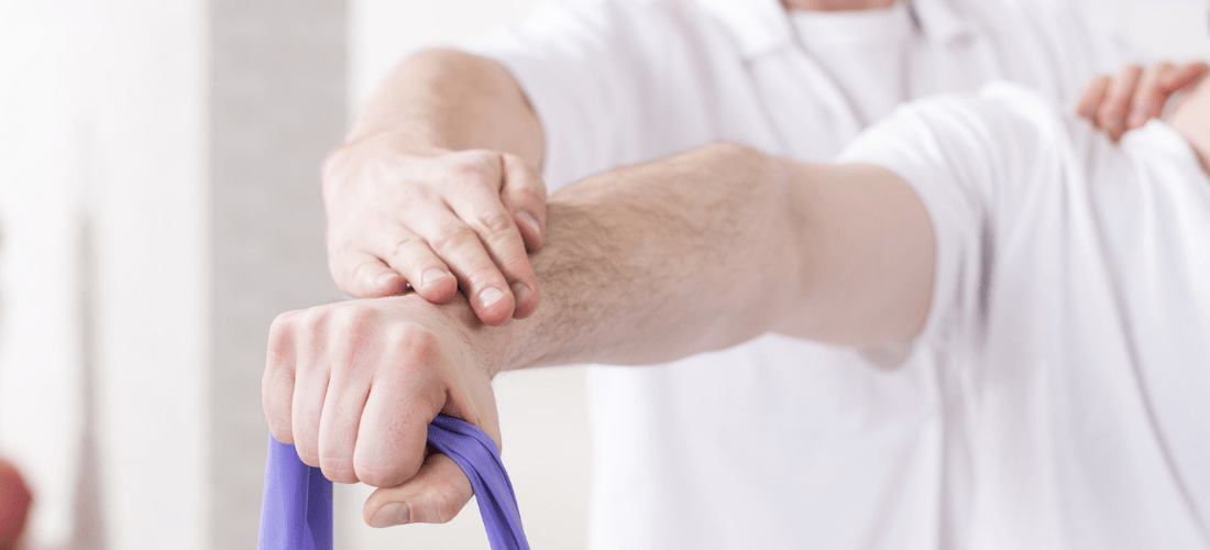physical therapist working on patient arm